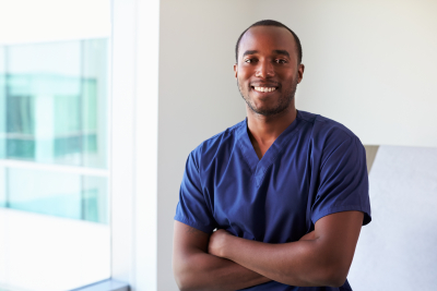 portrait of male nurse wearing scrubs